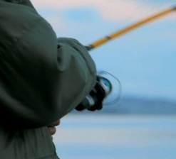 stock-footage-close-up-of-man-s-hands-reeling-in-a-fishing-pole