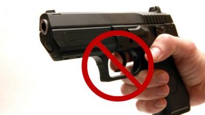 Gun pointed isolated on white bakcground