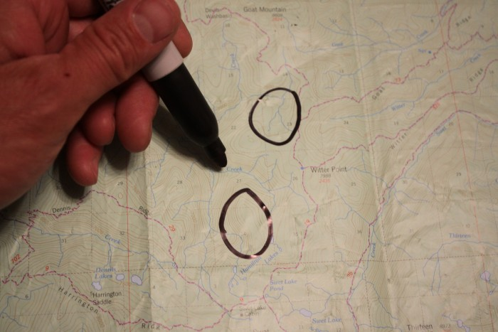 Circled areas  with hand representing a flat valley bottom and a flat creek bottom at the headwaters of a drainage likely to hold elk.  Walrath 2015